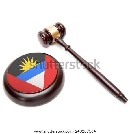 Judge gavel and soundboard with national flag on it - Antigua and Barbuda - stock photo