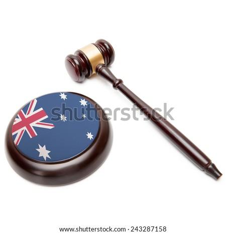 Judge gavel and soundboard with national flag on it - Australia - stock photo