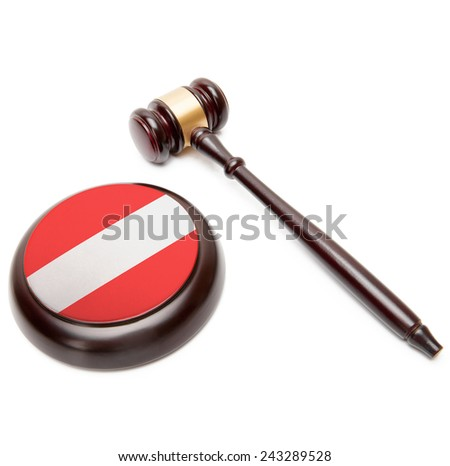 Judge gavel and soundboard with national flag on it - Austria - stock photo