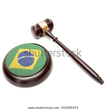 Judge gavel and soundboard with national flag on it - Brazil - stock photo