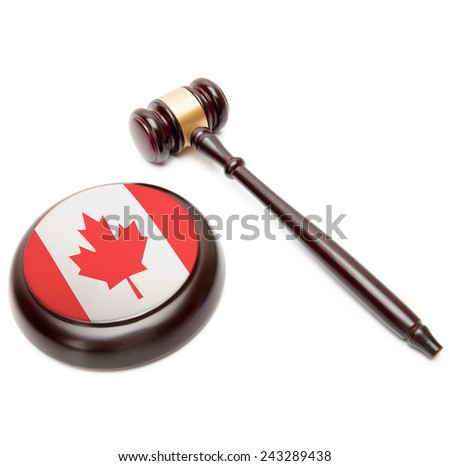 Judge gavel and soundboard with national flag on it - Canada - stock photo