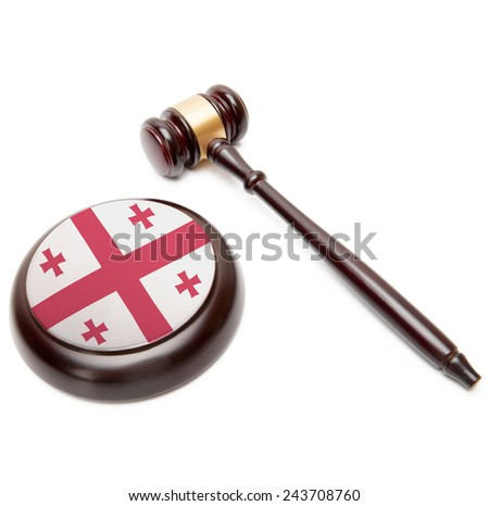 Judge gavel and soundboard with national flag on it - Georgia - stock photo