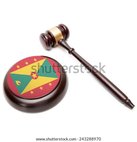 Judge gavel and soundboard with national flag on it - Grenada - stock photo