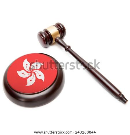Judge gavel and soundboard with national flag on it - Hong Kong - stock photo