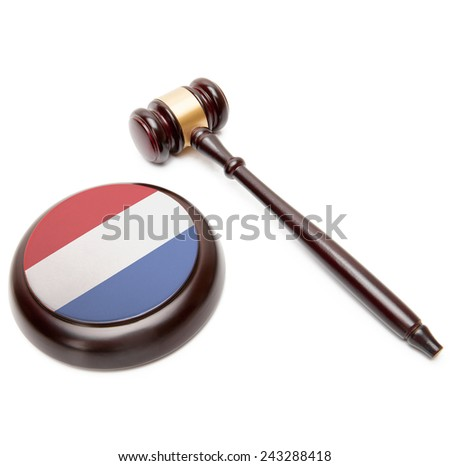 Judge gavel and soundboard with national flag on it - Netherlands - stock photo