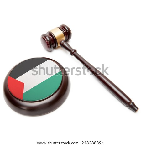 Judge gavel and soundboard with national flag on it - Palestine - stock photo