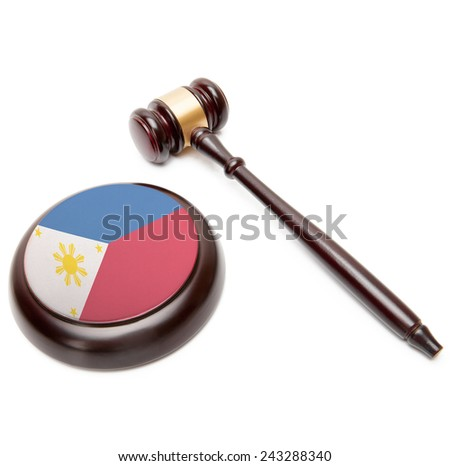 Judge gavel and soundboard with national flag on it - Philippines - stock photo