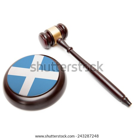 Judge gavel and soundboard with national flag on it - Scotland - stock photo