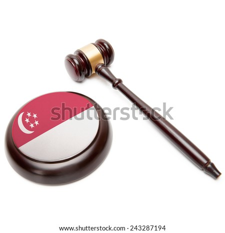 Judge gavel and soundboard with national flag on it - Singapore - stock photo