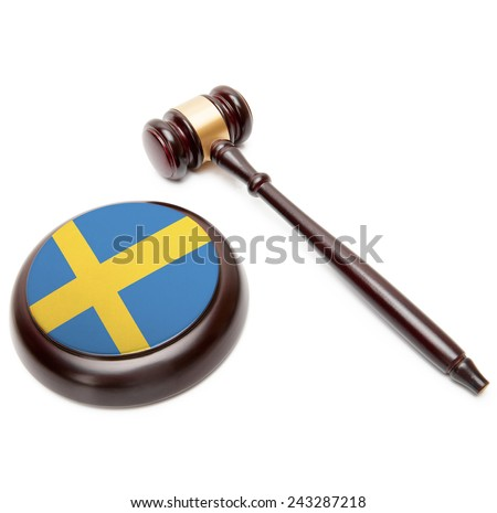 Judge gavel and soundboard with national flag on it - Sweden - stock photo
