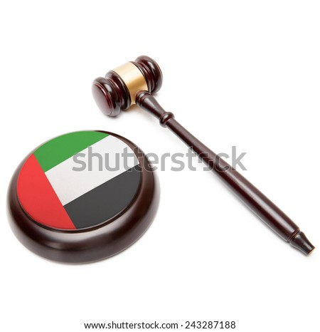 Judge gavel and soundboard with national flag on it - United Arab Emirates - stock photo