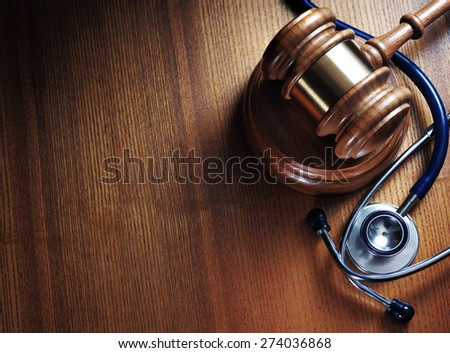 Judge gavel and stetaskop on wooden background. Close up - stock photo