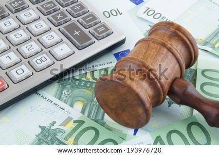 Judge gavel, calculator and euro banknotes - stock photo