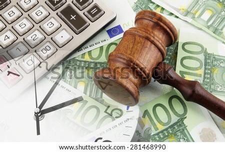 Judge gavel, clock, calculator and euro banknotes - stock photo