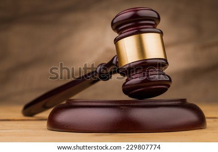 judge gavel closeup on wooden table