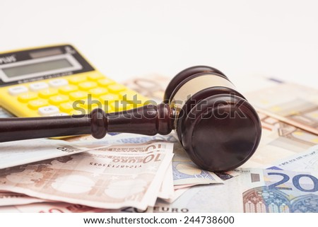 Judge gavel, euro banknotes and calculator  - stock photo