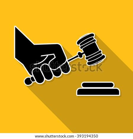 judge gavel in hand symbol - stock photo