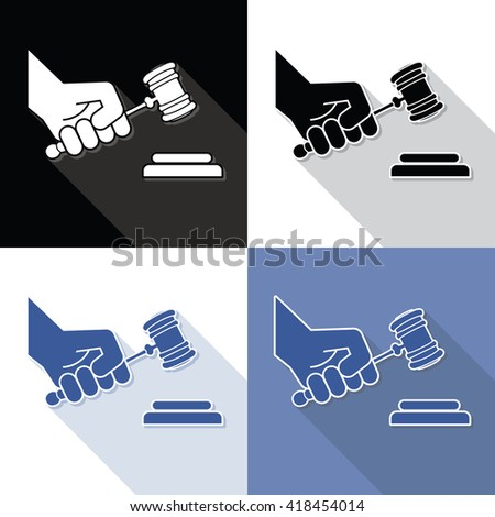 Judge gavel in hand symbols - stock photo