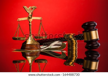 judge gavel, money and scales of justice - stock photo