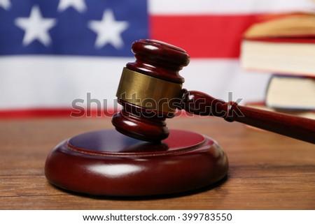 Judge gavel on American flag background - stock photo