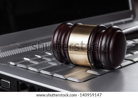 judge gavel on computer cyber crime concept