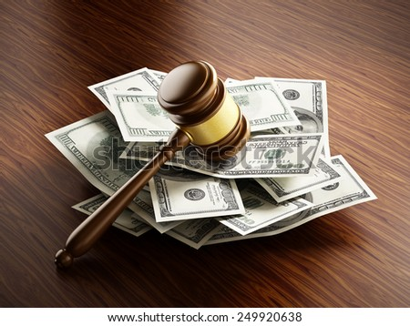 Judge gavel on 100 dollar paper money pile. - stock photo