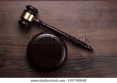 judge gavel on the brown wooden background - stock photo