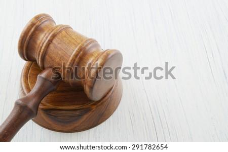Judge gavel on white table  - stock photo