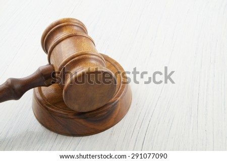 Judge gavel on white table with room for text - stock photo