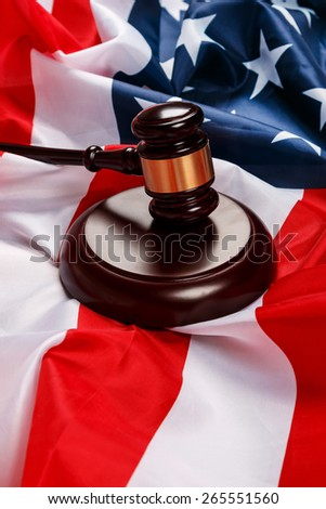 Judge gavel over american flag - stock photo