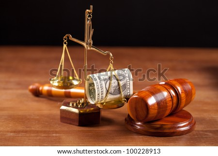 judge gavel scales with money