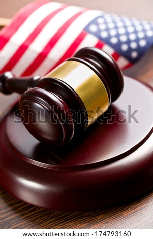 judge gavel with american flag on wooden background