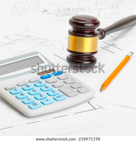 Judge gavel with calculator and pencil - 1 to 1 ratio - stock photo