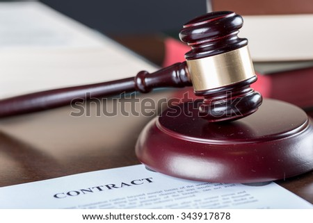 Judge gavel with contract