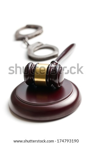 judge gavel with handcuffs on white background - stock photo