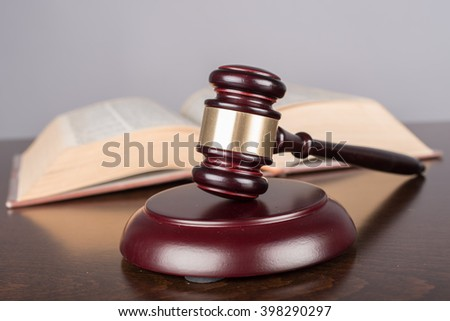 Judge gavel with law book