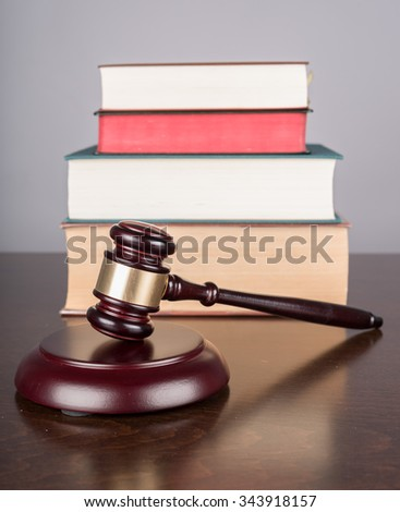Judge gavel with law books