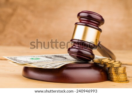 judge gavel with money closeup