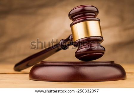 judge gavel with money  on wooden  table closeup