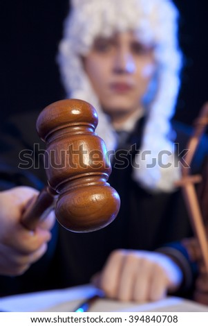 Judge. Male judge in a courtroom striking the gavel - stock photo