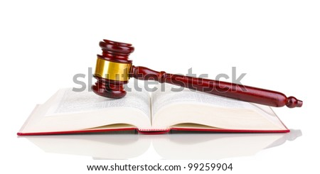 Judge's gavel and open book isolated on white - stock photo