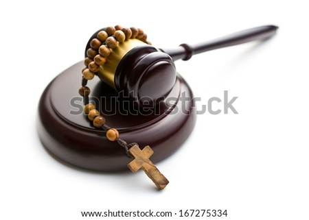 judge's gavel and rosary beads on white background - stock photo