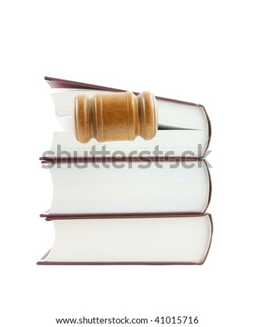 Judge's gavel and stack of legal books isolated on white