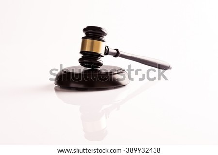 Judge's gavel on white background with reflection - stock photo
