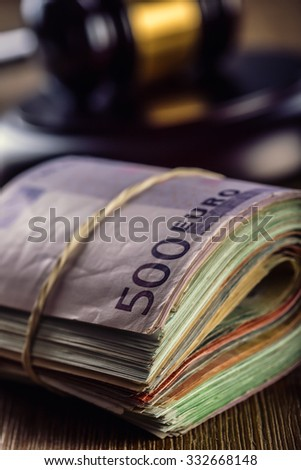 Judge's hammer gavel. Justice and euro money. Euro currency. Court gavel and rolled Euro banknotes. Representation of corruption and bribery in the judiciary. - stock photo