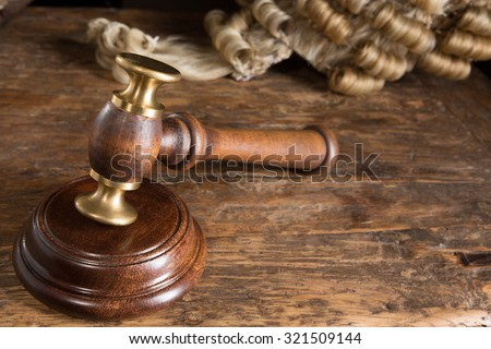 Judge's hammer or gavel and his horsehair wig - stock photo