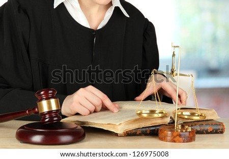 Judge sitting at table during court hearings on room background - stock photo