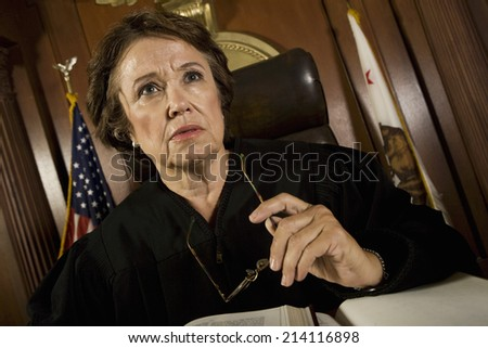 Judge sitting in court - stock photo