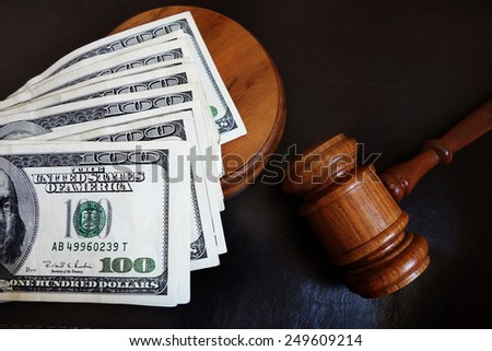 Judges court gavel and assorted money                                - stock photo
