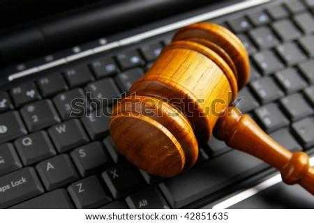judges court gavel closeup  on a laptop - stock photo